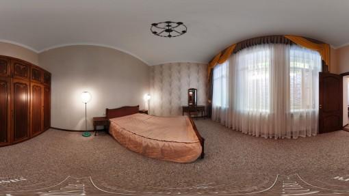 Фото спальни двухкомнатного номера Горный воздух